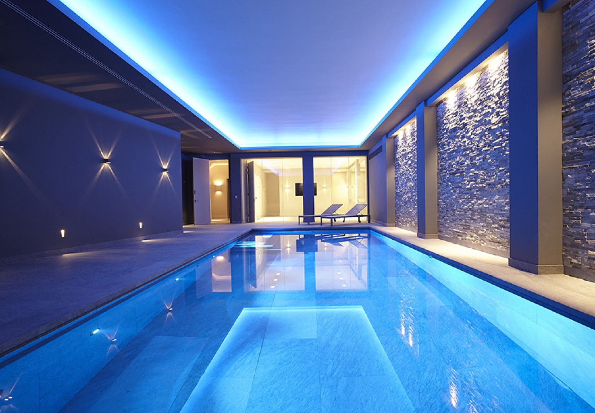 Colourful basement pool london guncast swimming pools - Indoor swimming pool with slides london ...