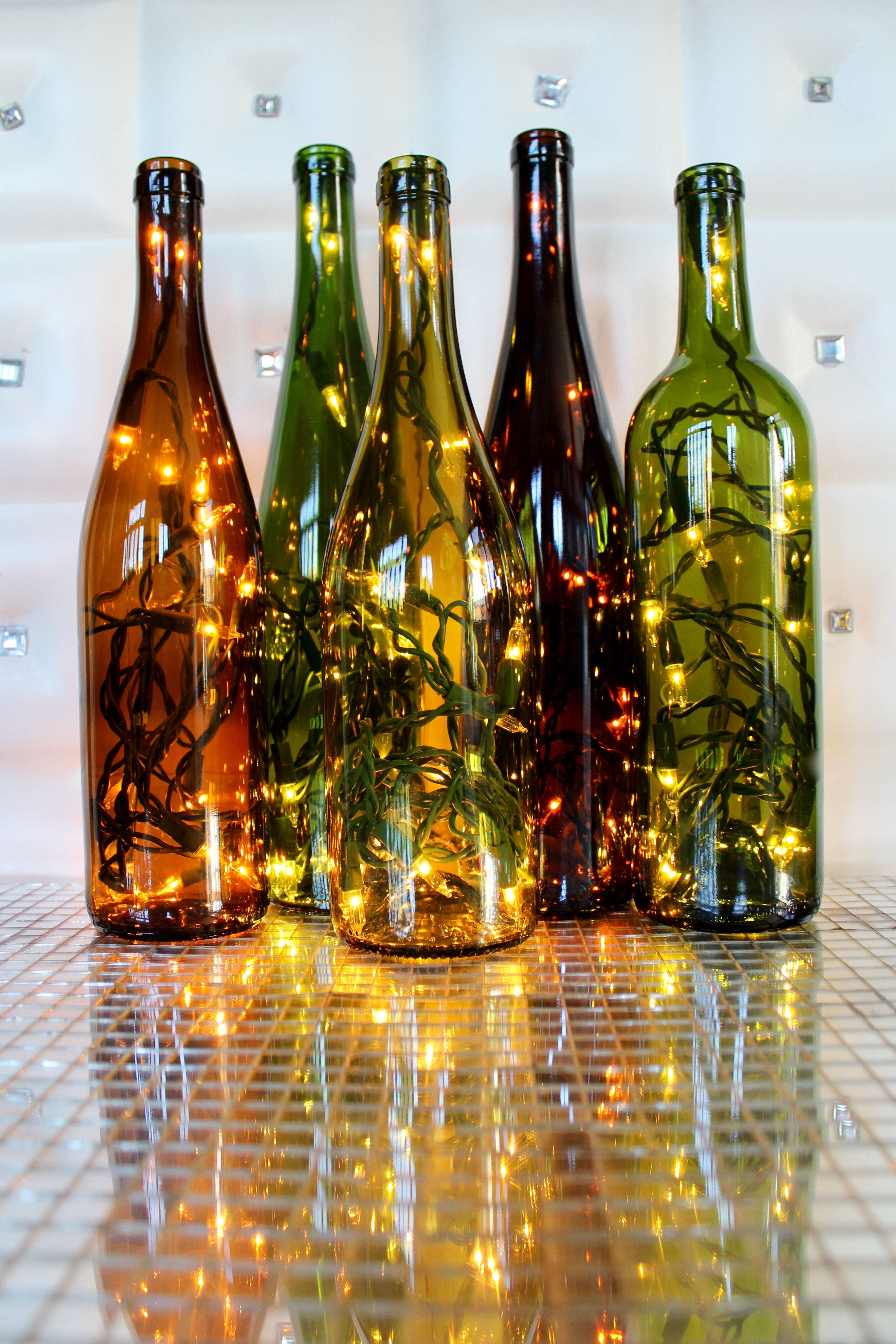 Classy Garbage lighted wine bottles make the