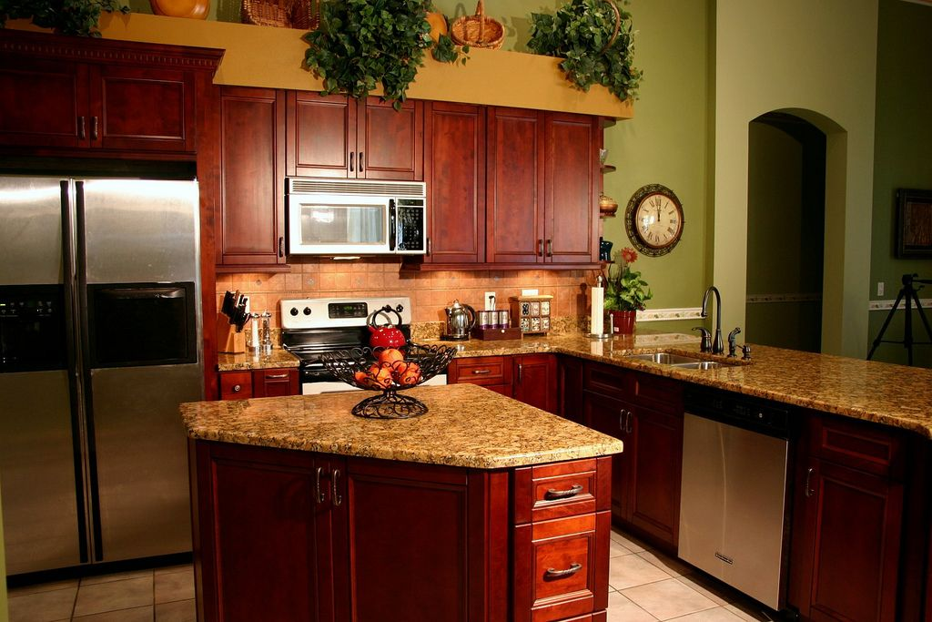a cherry kitchen with a small island and a big breakfast bar kitchen remodel small kitchen on kitchen island ideas kids id=98417
