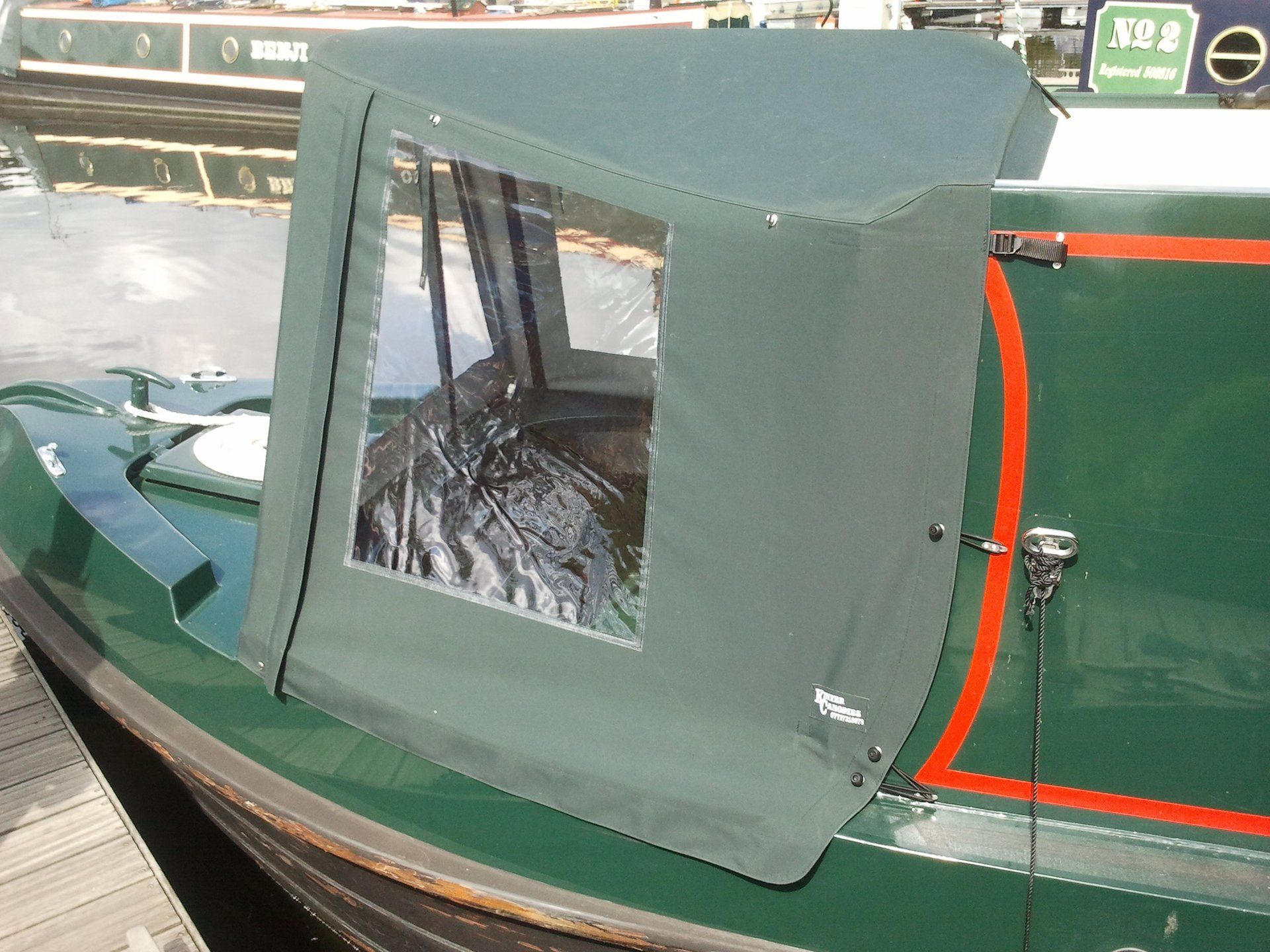 Framed cratch cover view from the side. Narrowboat Wide