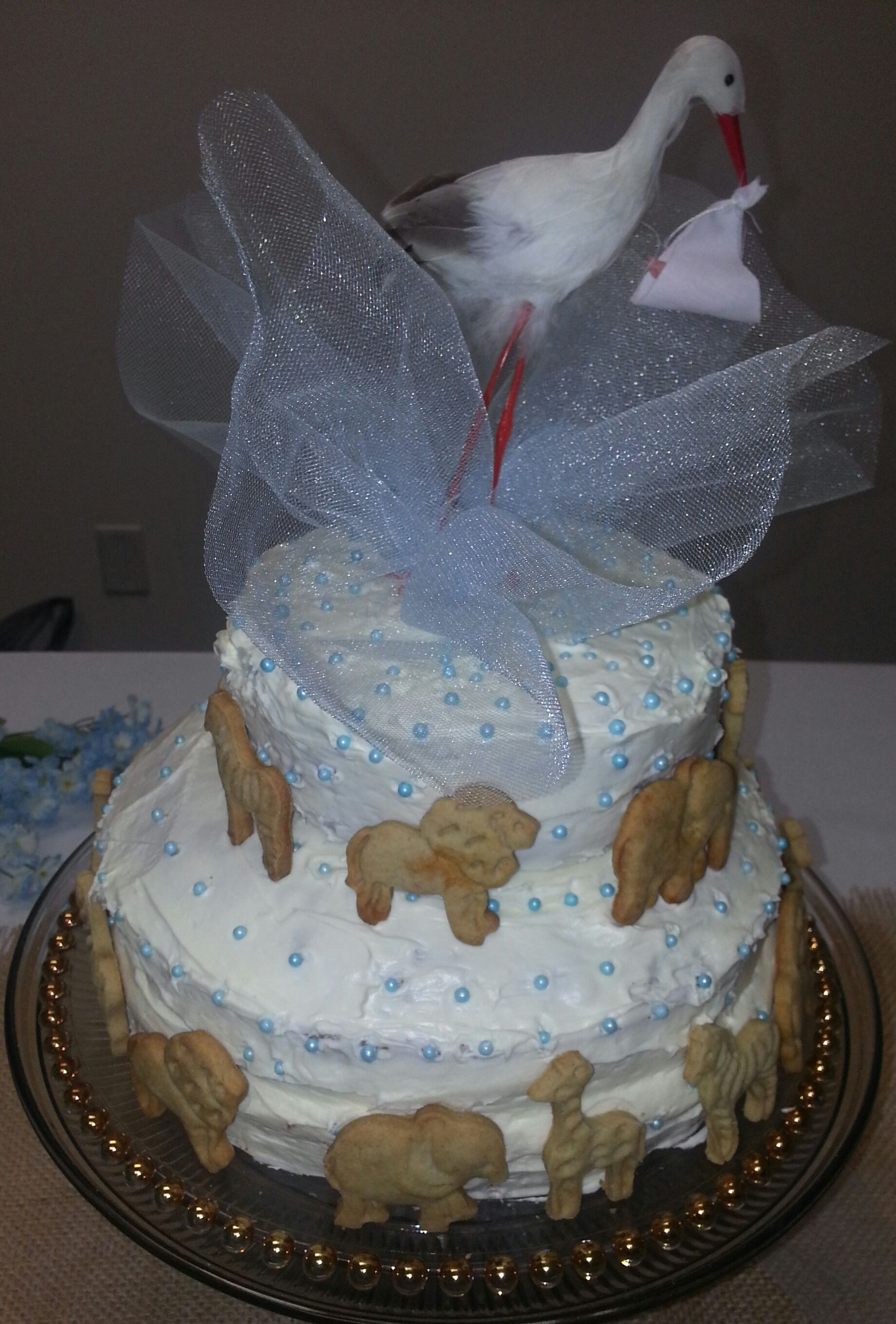 Simple two layer cake decorated with a stork and homemade ...