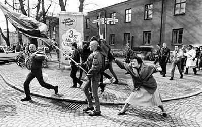 A woman hitting a neo-Nazi with her handbag.