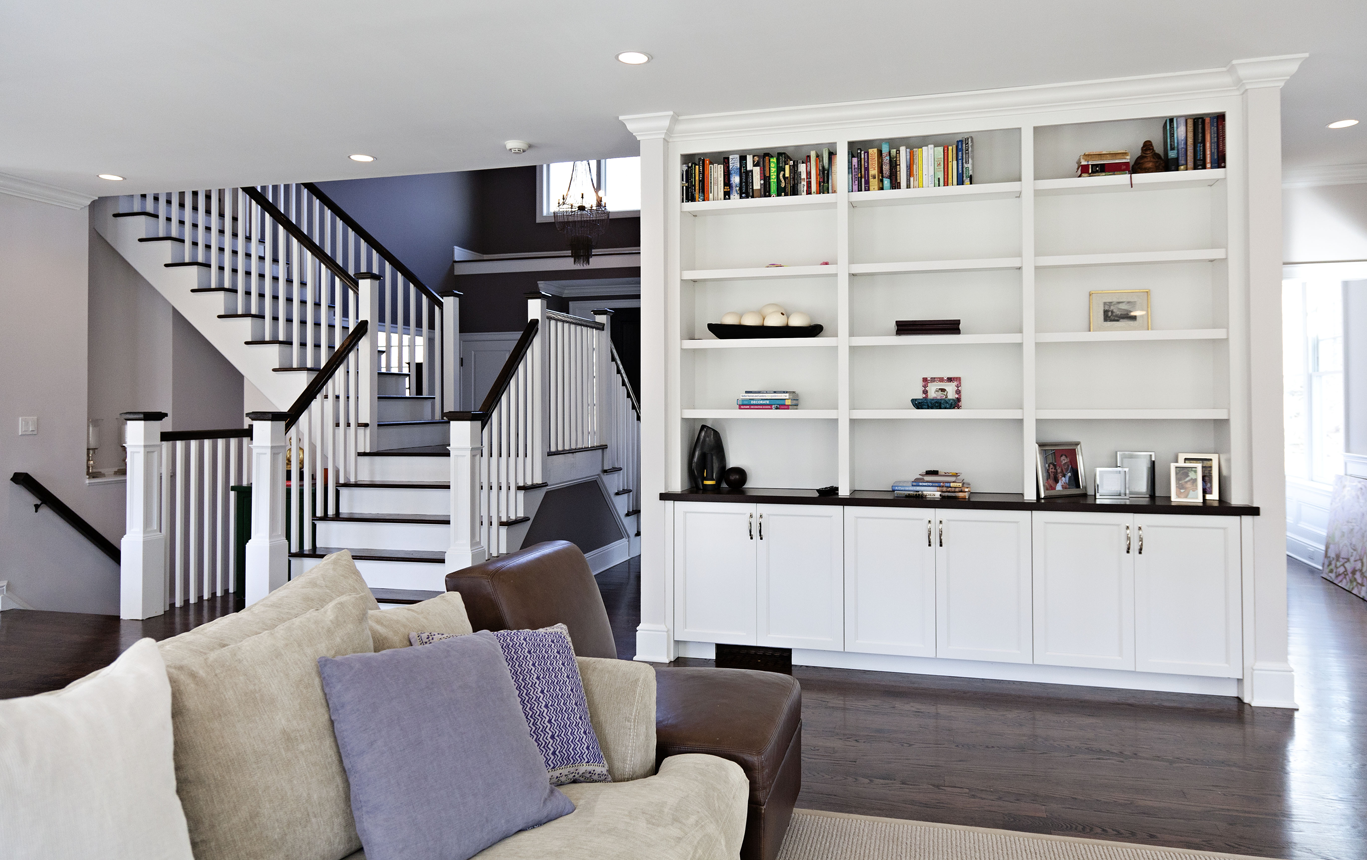 Huge double-sided home staircase and built-in cabinet ...