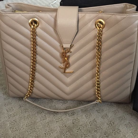 Yves Saint Laurent Handbag Brand new never worn with tags receipt cards dust bag and box Nude with Gold chain YSL handbag- SERIOUS offers only please otherwise I would prefer to keep.  Thank you! I paid $2,775 total including tax- price is higher due to how much Poshmark takes Yves Saint Laurent Bags