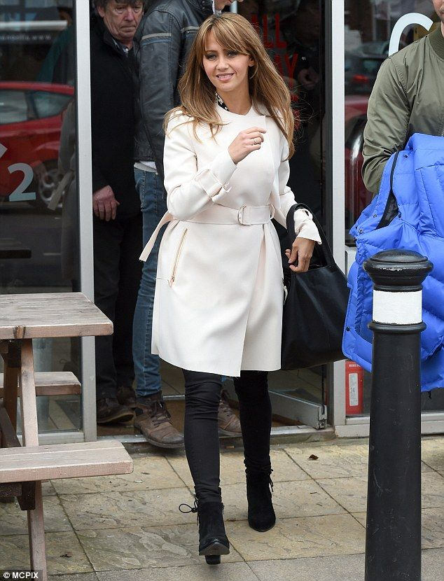 Fabulous figure:Samia wrapped up warm against the Manchester chill in a cream coloured coat and black jeans whilst filming her first scenes after a six month break