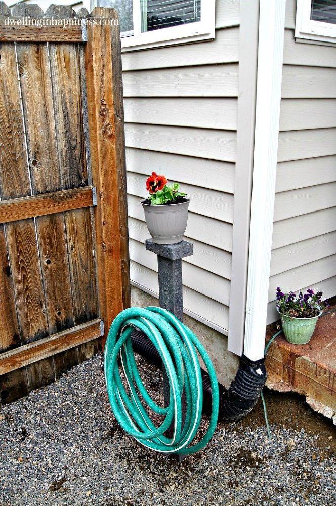 a blogger buys a single 2x4 at home depot using utility hooks she makes this garden hose hangergarden hose storageflower
