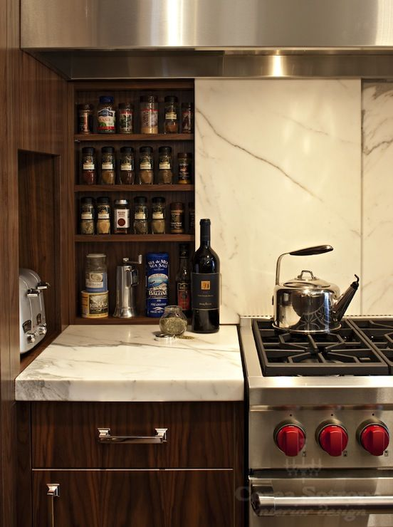 Modern Veneer Kitchen Cabinets Paired With Marble Slab Countertops And  Marble Slab Backsplash.