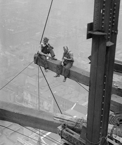 Construction workers relaxing on a steel beam, 1926
