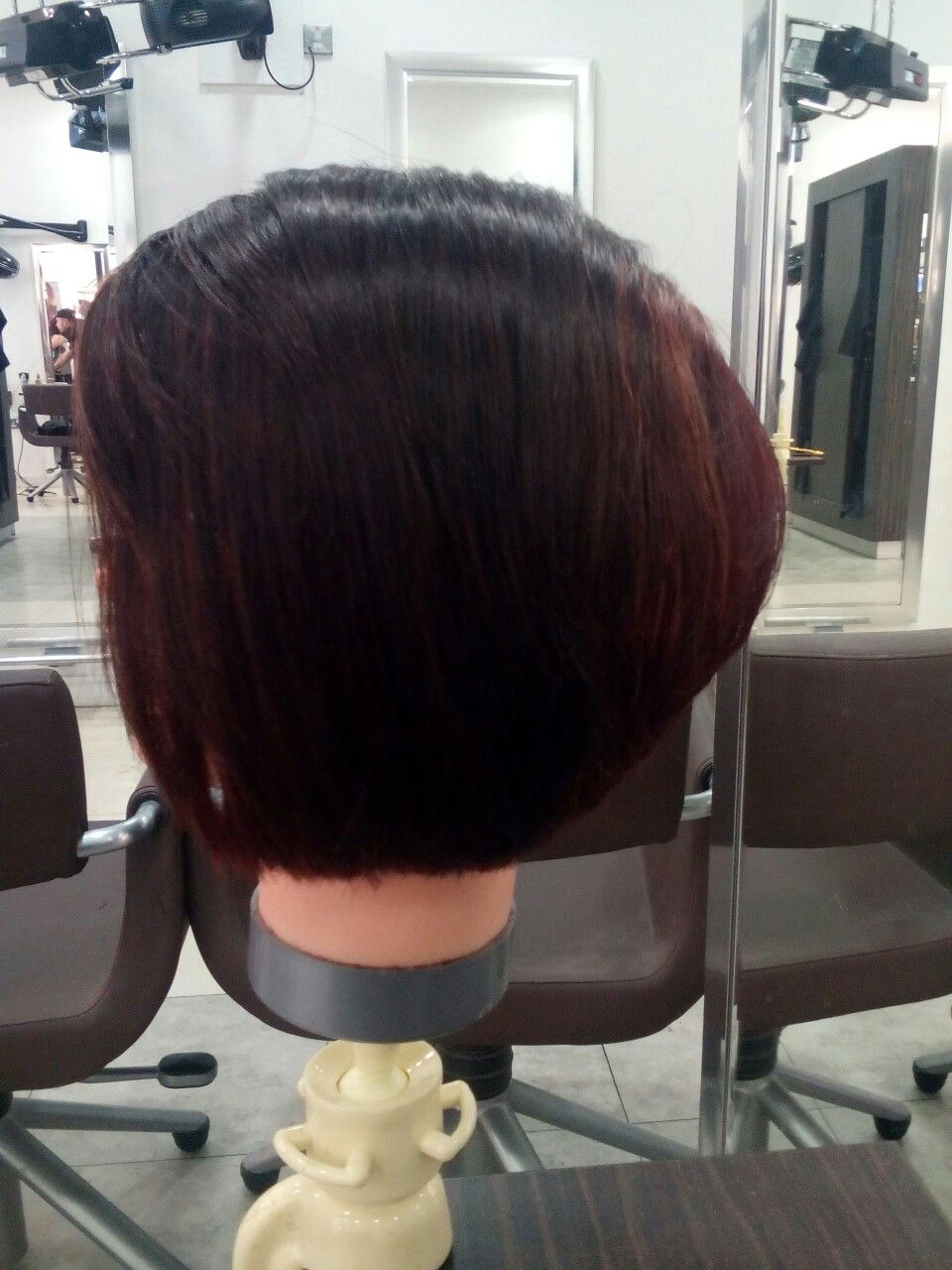 Classic Bob Haircut With Layers At The Back Section And Combination
