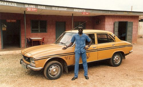 dynamicafrica: a classic peugeot 504 in abeokuta, nigeria - once a
