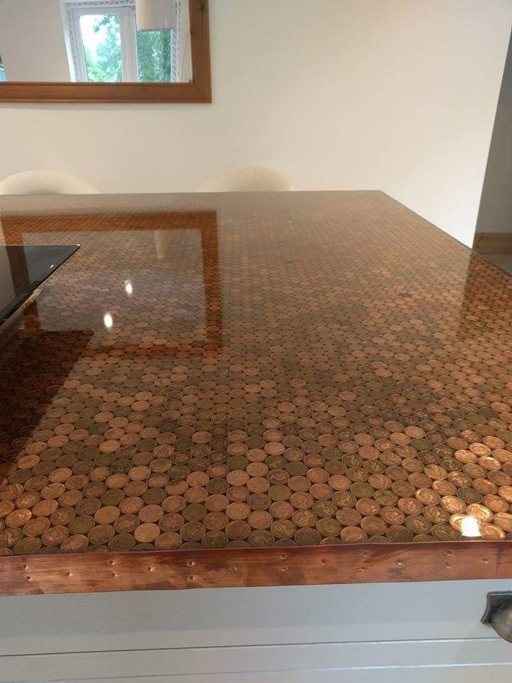 Penny worktop made using coins, copper edging and clear epoxy resin ...