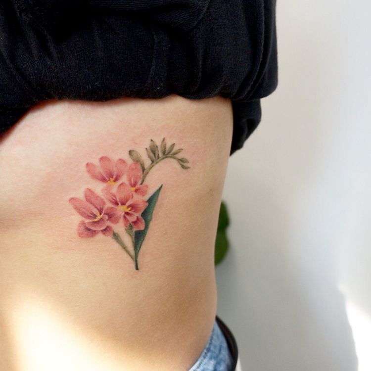 22 Beautiful And Delicate Freesia Tattoo Designs Page 2 Of 2 Tattooadore Flower Tattoo Pastel Tattoo Pink Flower Tattoos