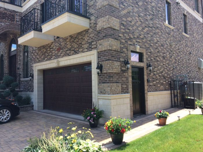 Superb Precast Thin Stone Wall Panels Used As A Water Table Around House. Stone  Moldings Also