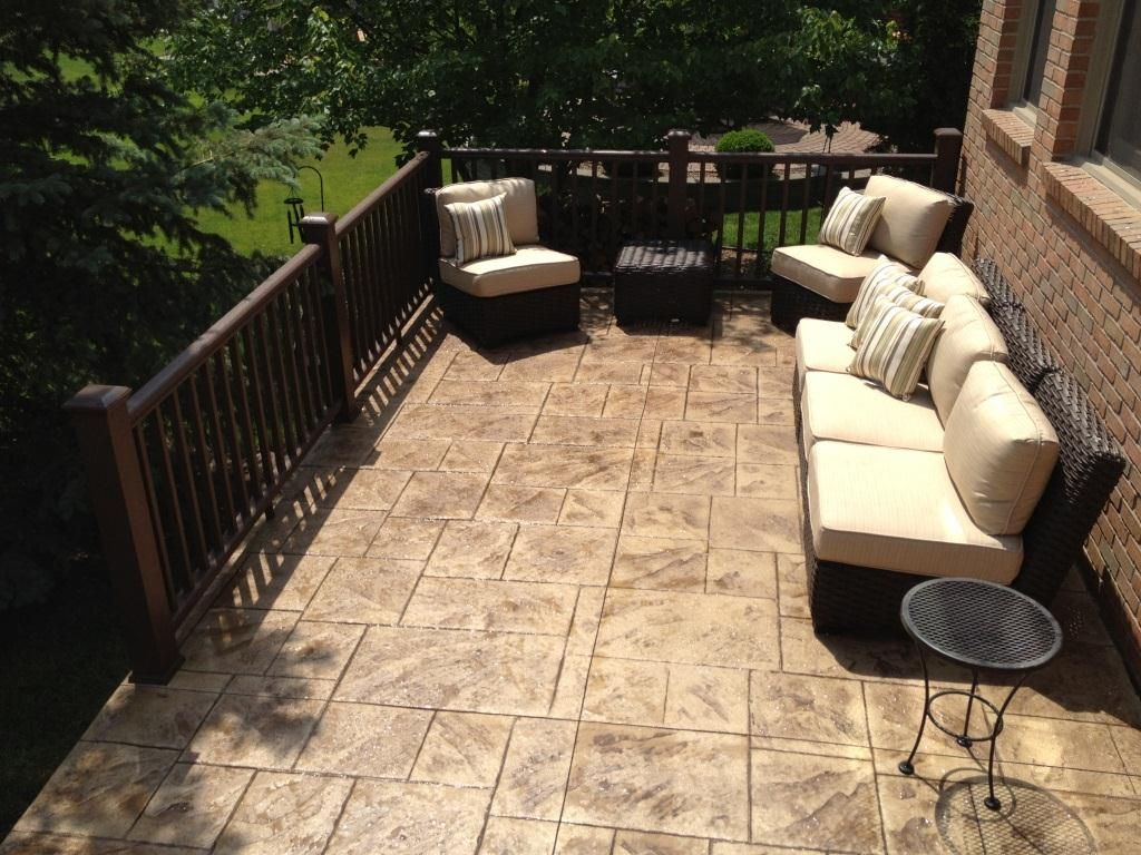 raised stamped concrete patio with timber tech express rail