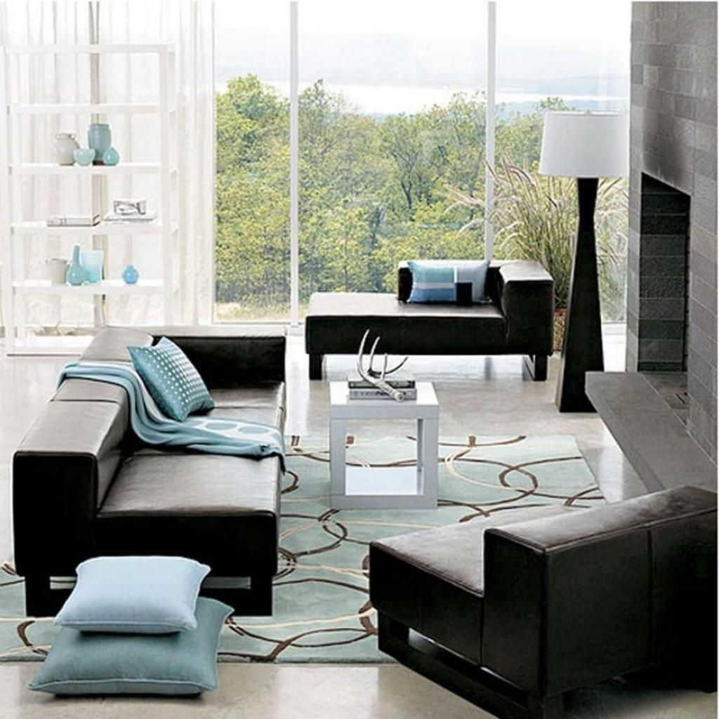 Intriguing living room with aqua blue area rug and Black sofa decor