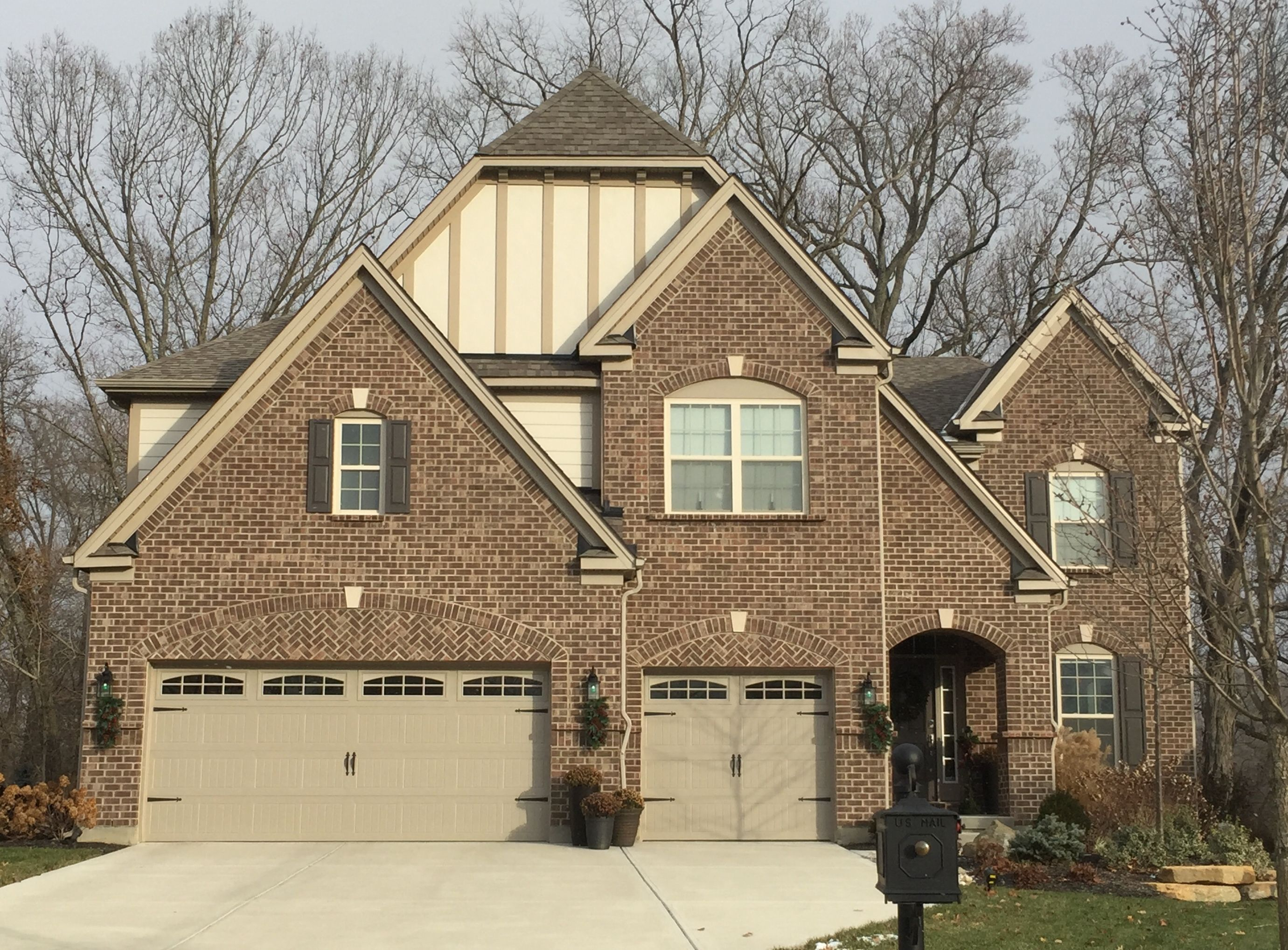 INDIANA MILLSTONE BRICK, COBBLESTONE SIDING, CLAY TRIM, MUSKET BROWN  SHUTTERS, SANDSTONE GARAGE