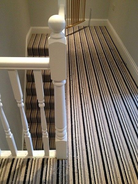 striped carpet stairs and landing