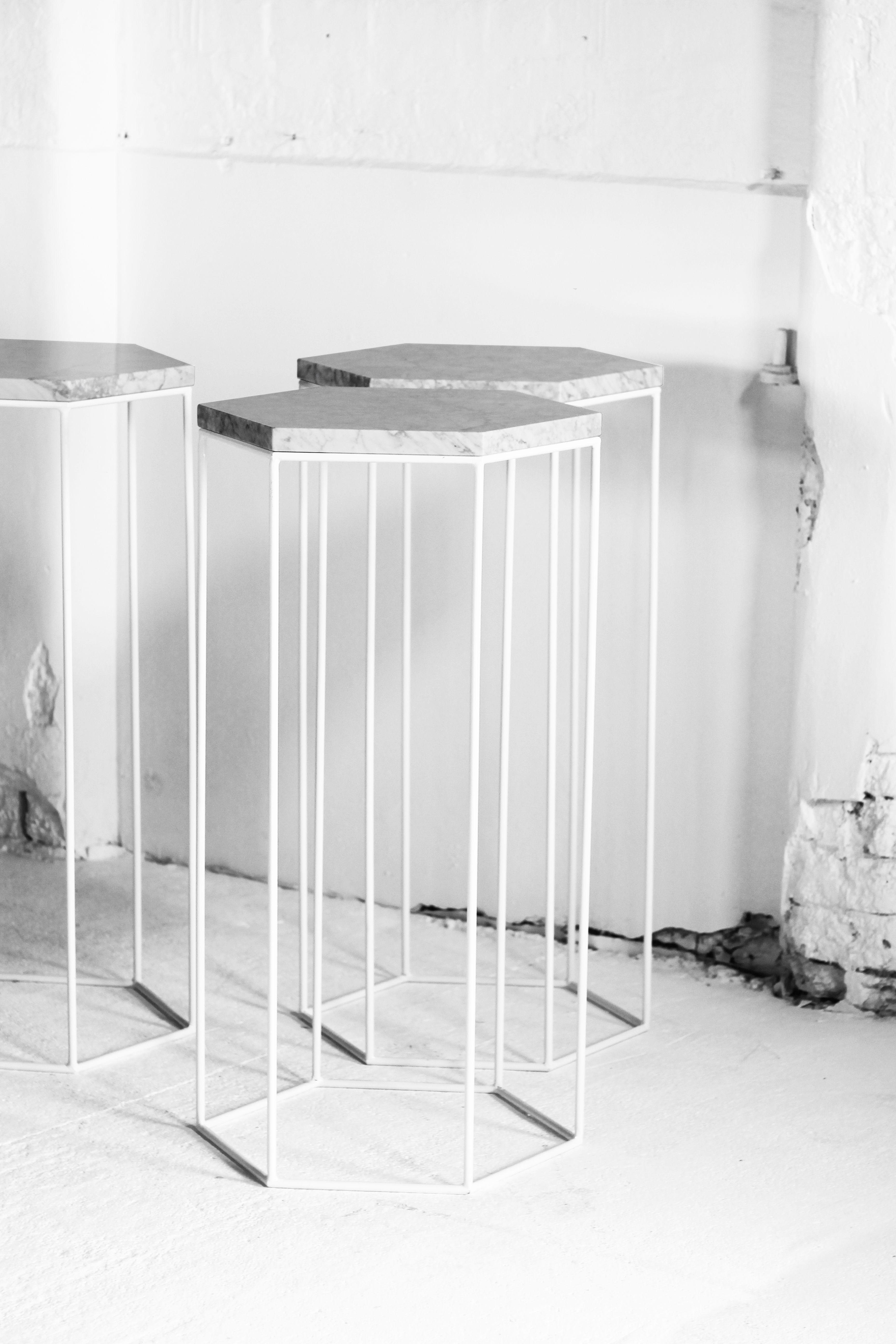 Hexagonal frame plinths with marble tops display exhibition plinths plinths london