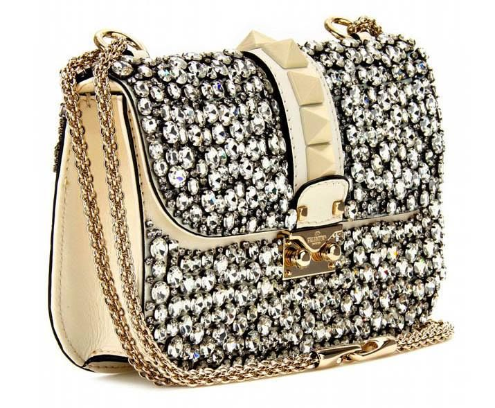 Be sure to dazzle with Valentino's medium sized crystal-embellished lock shoulder bag - LUXURE loves!