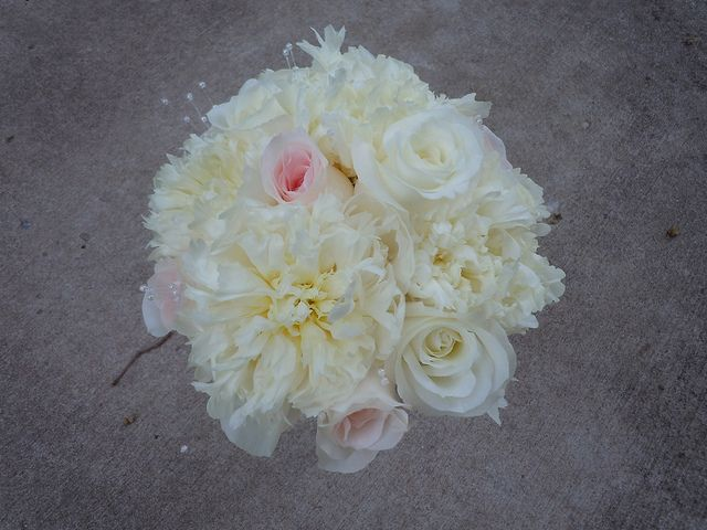 Bridesmaid bouquet of white peonies, white roses and pale pink roses with pearls Designed By: hillside-consultants.com
