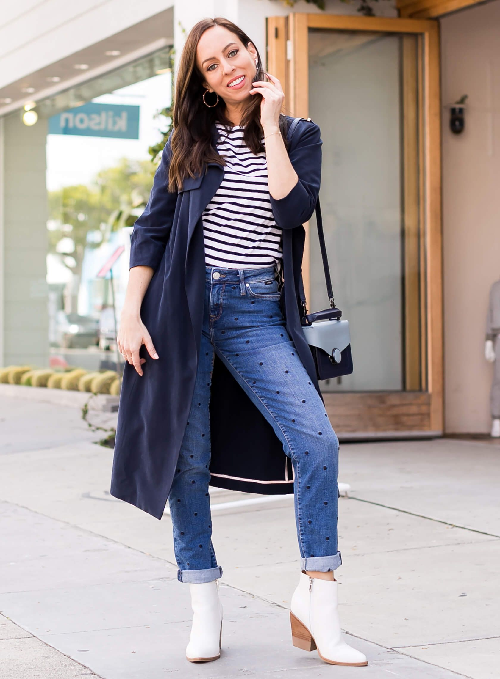 74196c6de466 Sydne Style shows how to mix prints in polka dot jeans and striped tee # polkadots #jeans #trench #stripes #mixedprints @sydnesummer