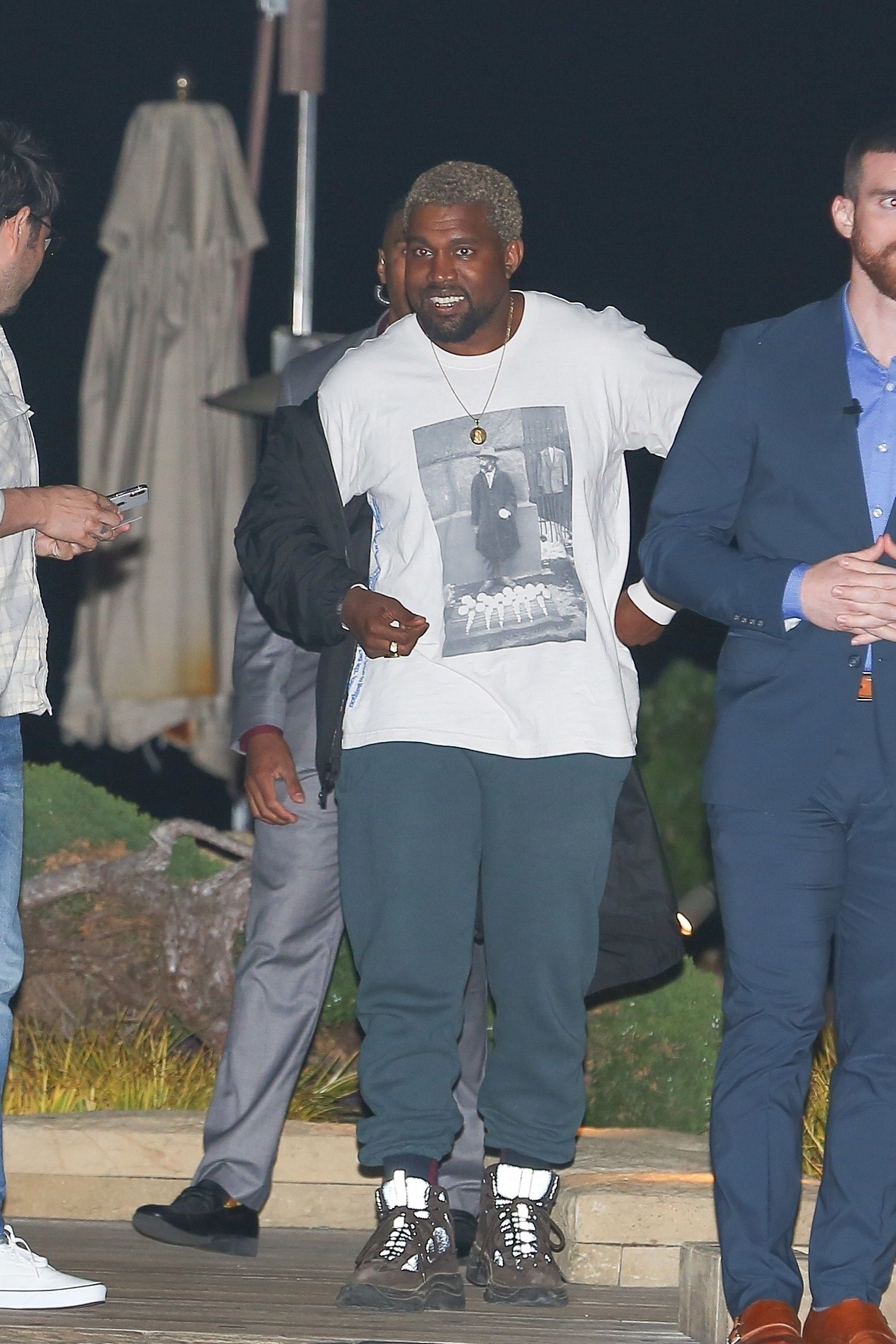 b9e2cc3a8 Kanye West wearing No Vacancy Inn David Hammons Tribute Set For NYFW