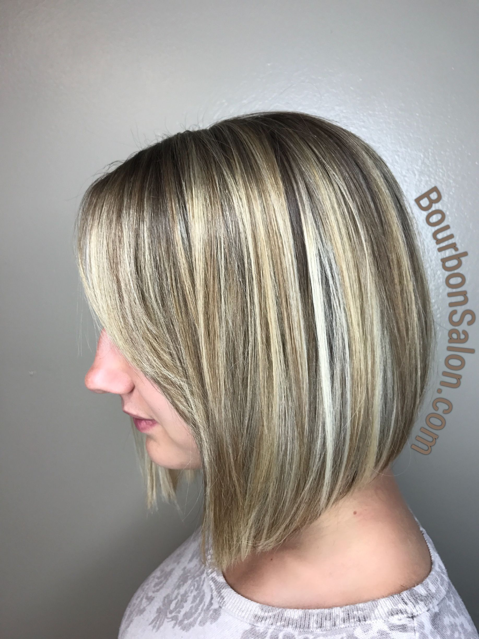 Angled Bob With Side Swept Bangs And Blonde Highlights Hair Blonde Highlights Cool Hairstyles