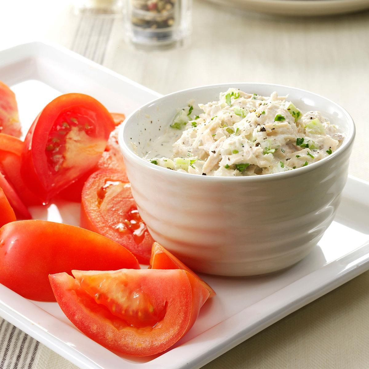 Crunchy Tuna Salad with Tomatoes Recipe -On a hot summer day, there's nothing more refreshing than one of these. I grow a few tomato plants in my garden and the fresh-picked taste makes the recipe even more of a treat. —Diane Selich, Vassar, Michigan