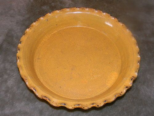 10in wide x 2in deep old yellow ware pie plate