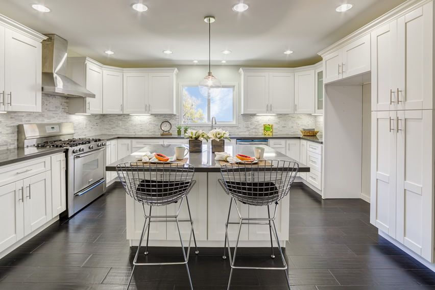 Bright White Upscale Kitchen With Eat In Island