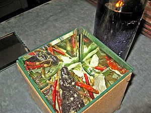 A box spell made of mirrors turned inward to reverse and bind evil spells onto the woman who sent them to a rootworker's clients; the final mirror, which will form the mirror box lid, is at left