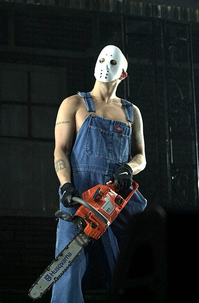 Credit: Haydn West/PA Rapper Eminem as his alter ego Slim Shady was rarely seen without his dungarees and chainsaw to accessorise