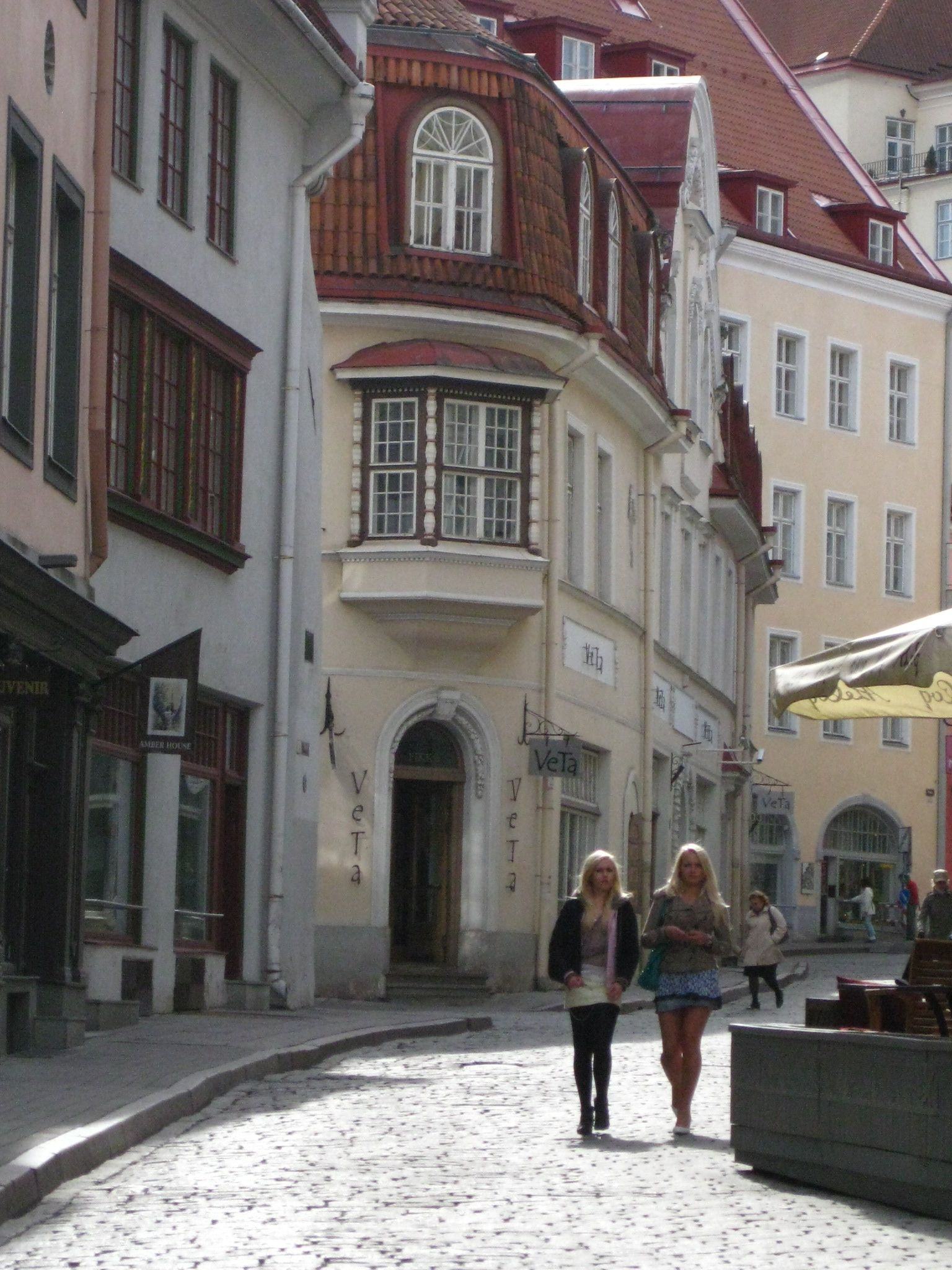 2 Estonian girls walking in Old Town Tallinn, Estonia