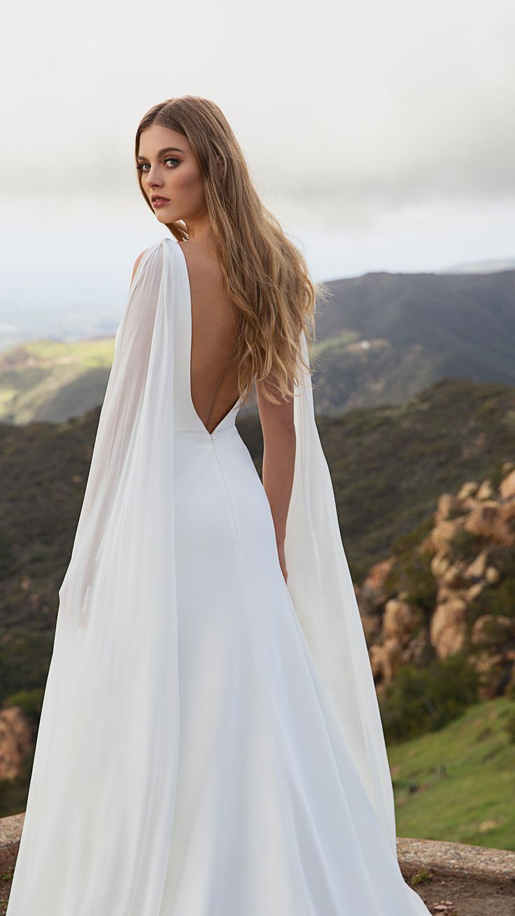 Simply Romantic The Wesley Gown Is A Sleek Fit Amp Flare Silhouette With A Dramatic Plungi Simple Wedding Gowns Classic Wedding Dress Wedding Dresses Simple [ 1308 x 736 Pixel ]