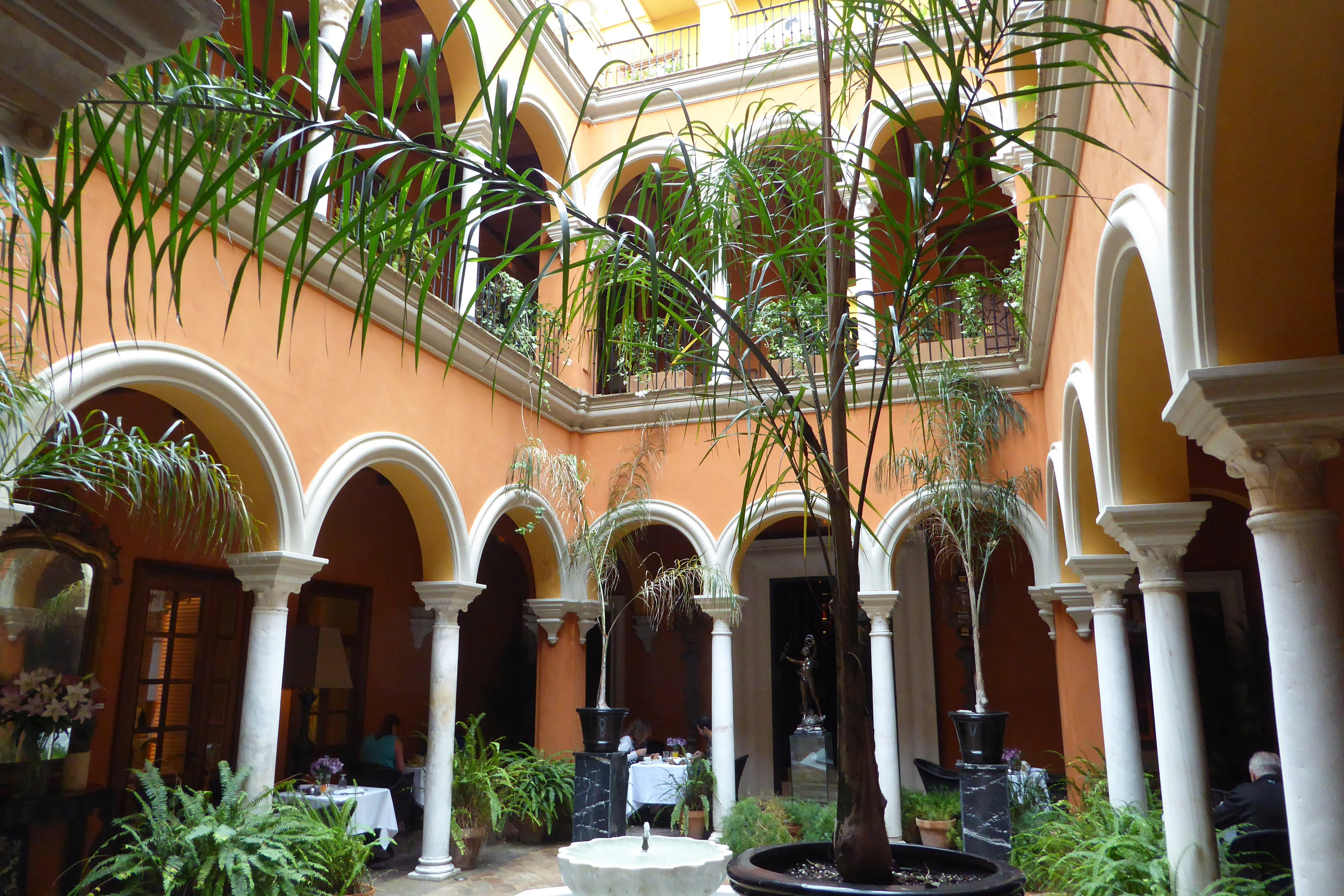 The apartment is set in old town district and offers access to the royal palace real alcazar. Courtyard of the Casa del Poeta Boutique Hotel located in ...