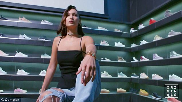 Stylish: For the video, she'd complemented a Chanel choker with gleaming hoop earrings, wearing a sleeveless black top with a baggy and torn pair of light blue jeans