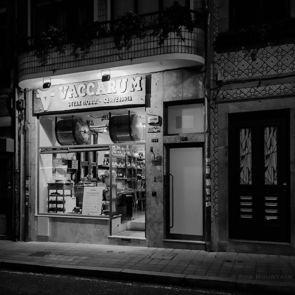 The Vaccarum Steak House in Porto, Portugal.  Image: © Rod Mountain  #flair_bw #bnw_captures #blackandwhiteisworththefight #bnw_life #noirecity #blackwhite #letsgosomewhere#worldshotz #stayandwander #folkgood #europe_tourist  #europe_perfection #CantSkipPortugal  #visitportugal #nightshot #nightphotography #photodocumentary #ourstreets #streetdreamsmag #streetleaks #streetphoto #streetphotography #photostreet #bnw_street #latergram #tbt