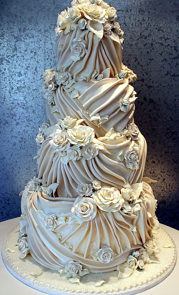 Cake in draped fondant with white chocolate roses
