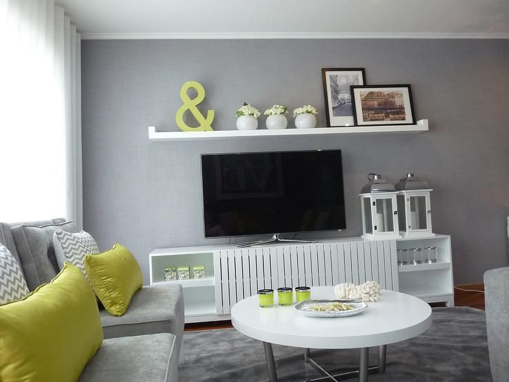 Love the green wall with grey couch and white accessories For