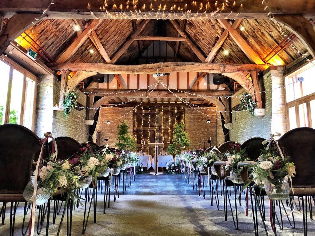 indoor barn wedding ceremony with floral