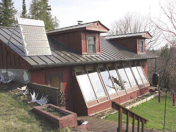 The abrahemson home an earth bermed house in minnesota for Earth bermed homes