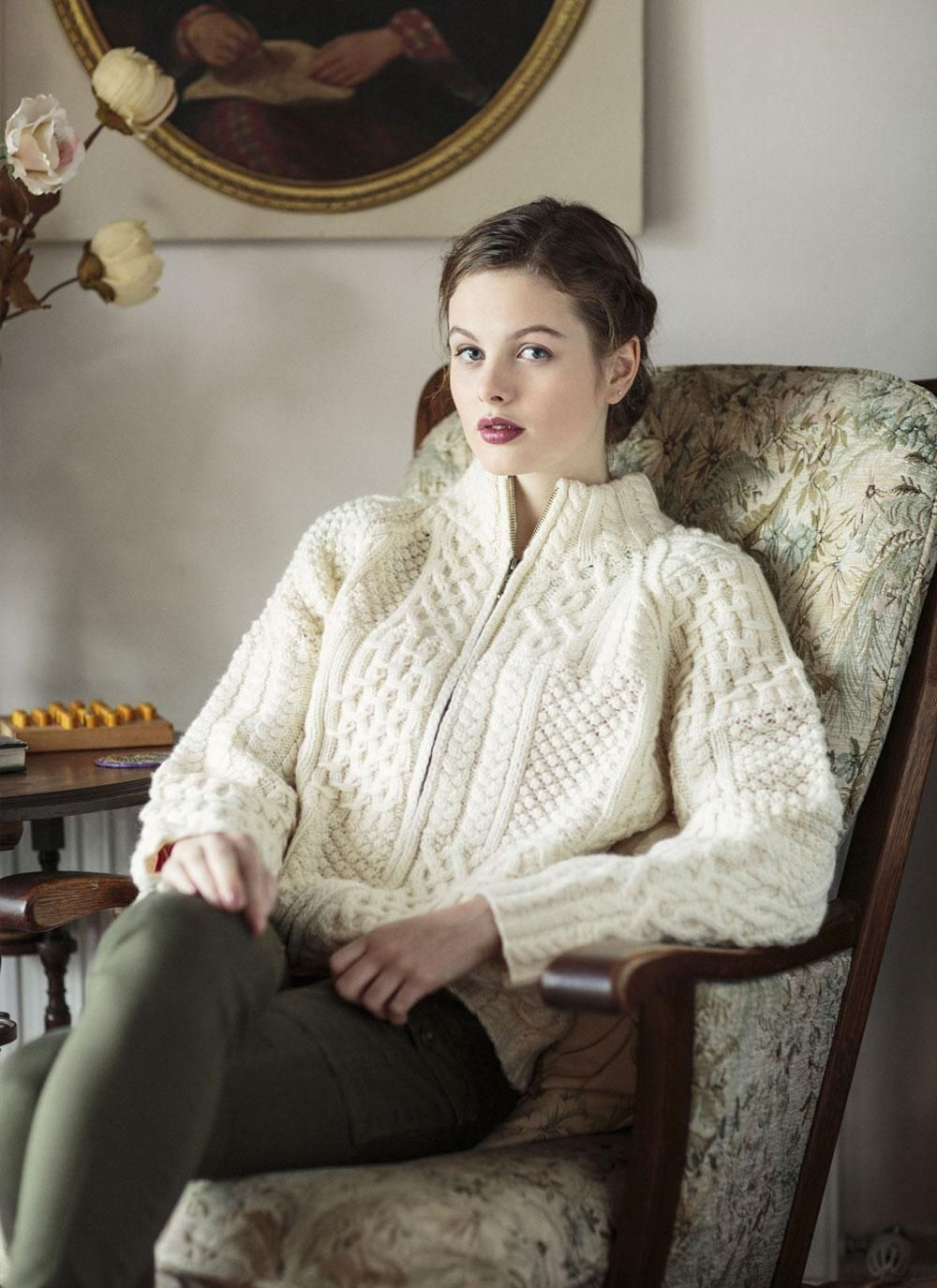 4a5eaae4d97a97 Aran Zip Cardigan  Our full-zip Aran Sweater has been handknit with 100%  merino wool. It has two front pockets and features an intricate blend of ...