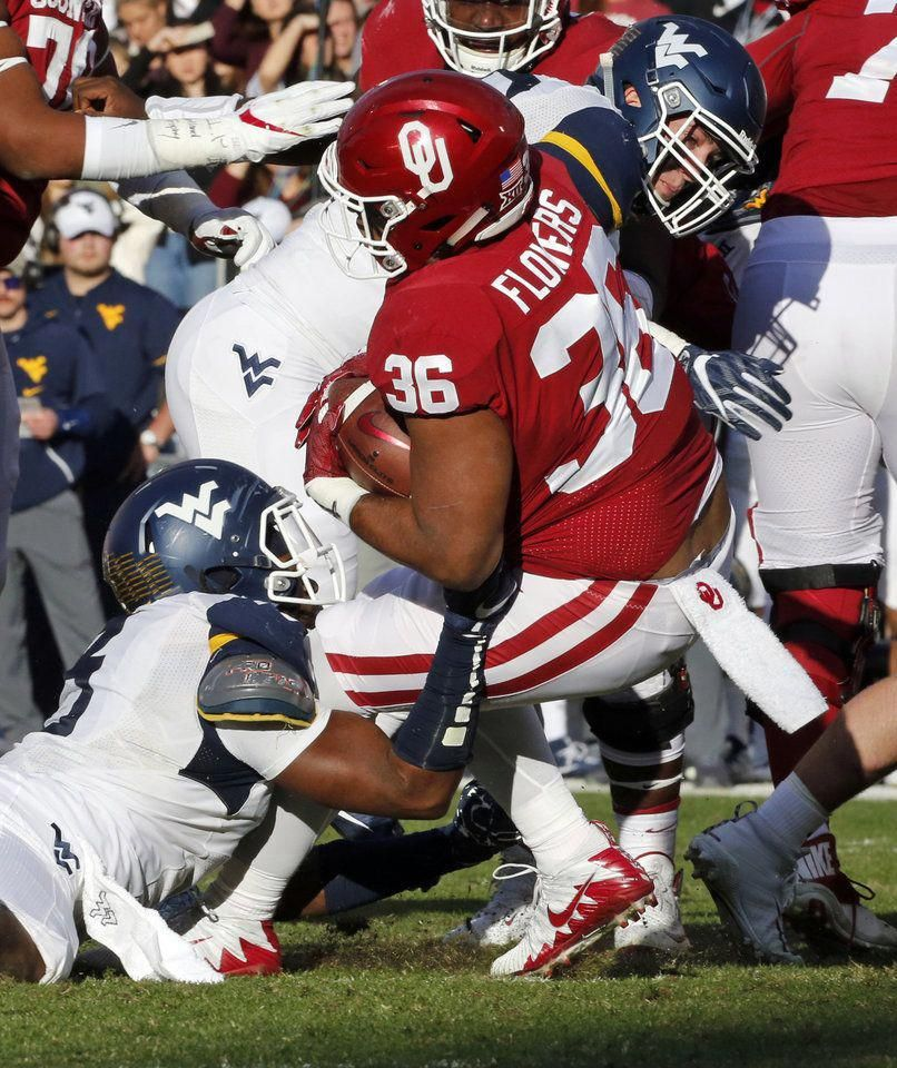 Oklahoma's Dimitri Flowers (36) carries the ball during a