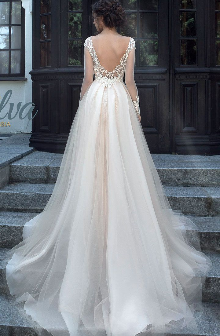 Long sleeve wedding dress with open back perfect for winter wedding