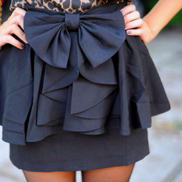 I love bows and ruffles, but my friends would murder me if i actually wore something like this haha