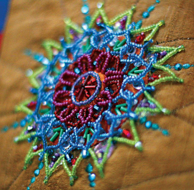 http://www.beadcreative.com/gallery/mandalas A side view of a beaded mandala.  I use the Elevated Beading technique I have developed. The directions are in my book Bead Creative Art Quilts. www.beadcreative.com/shop