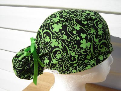 $15.99  This is a beautiful ponytail scrub hat for St. Patrick's day. It is a beautiful filigree of shamrocks done in a striking GREEN on a...