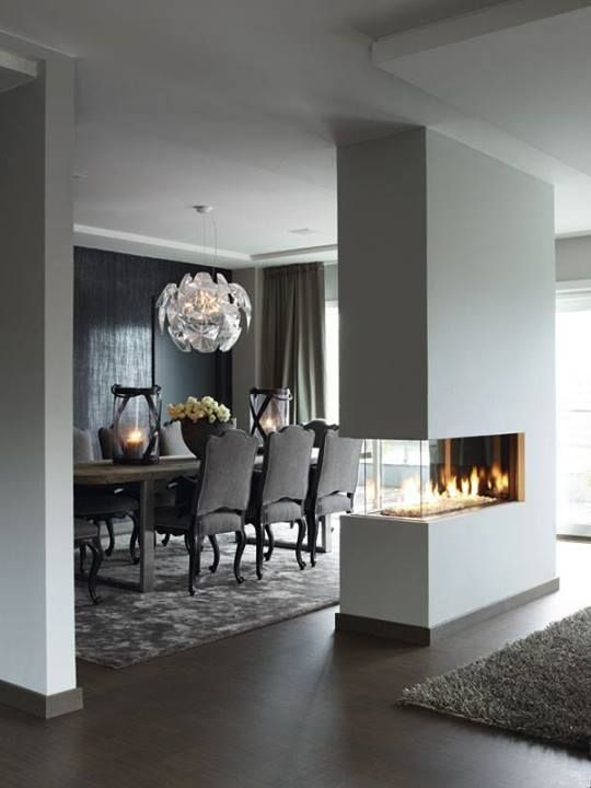 Love that fireplace! The blue colour on the accent wall in the background goes Well