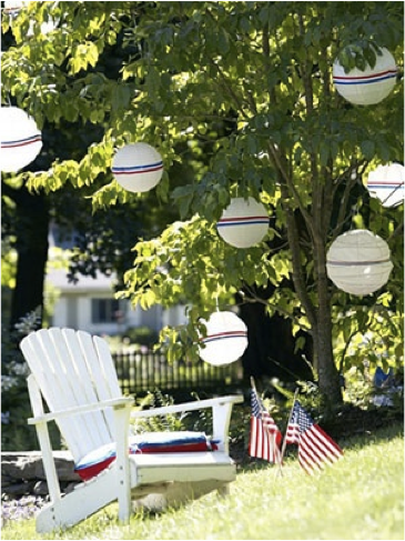 Easy Fourth of July decoration: use white paper lanterns and wrap red, white, and blue ribbon around the middle and hang them around your party area!