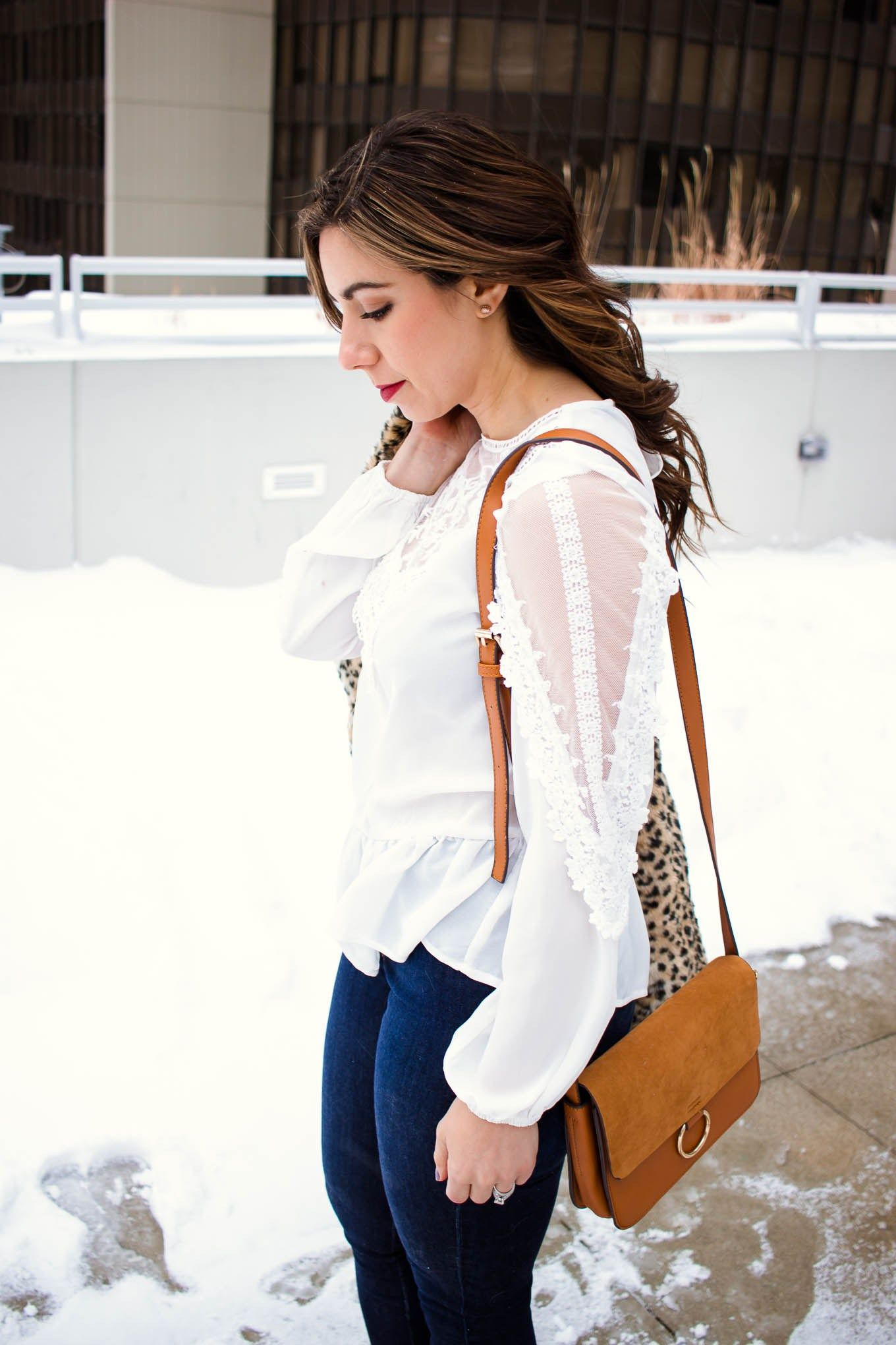 4e479e6ee5d Lifestyle blogger Roxanne of Glass of Glam wearing a white lace Shein top